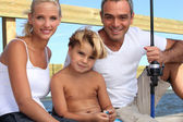 Portrait of a family fishing — Stock Photo