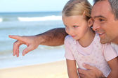 Father pointing something out to his daughter — Stock Photo