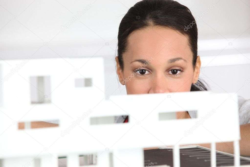 Woman observing architect plan — Stock Photo #8772884