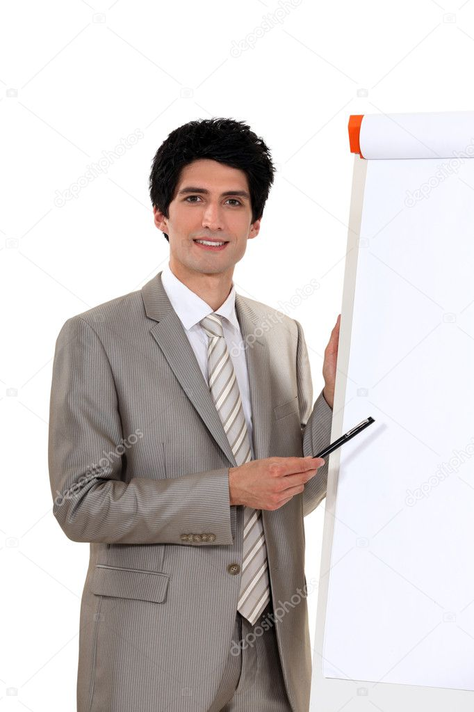 A businessman doing a presentation.  Stock Photo #8779121