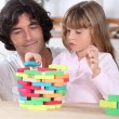 Father and child playing a game together — Stock Photo