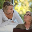 Young woman spending time with her grandmother — Stock Photo