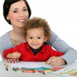 Mother drawing with child — Stock Photo