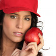 Woman with red hat and apple - Stock Photo