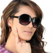 Woman wearing oversized sunglasses - Stock Photo