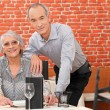 Couple posing in a restaurant — Stock Photo