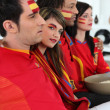Portrait of Spanish supporters watching soccer match on telly — Stock Photo #8782350
