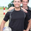 Rugby players smiling - Foto Stock