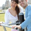 Smiling couple playing outdoors - Stock Photo