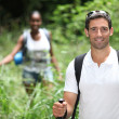 Couple hiking in the wilderness — Stockfoto