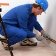 Stock Photo: Plumber fitting copper pipe