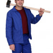 Construction worker holding a large mallet hammer — Stock Photo #8784948