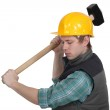 Young craftsman working with a huge hammer — Stock Photo
