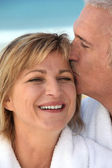 Husband kissing his wife — Stock Photo