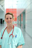 Medic in scrubs standing in a corridor — Stock Photo