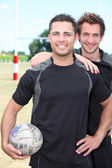 Rugby players smiling — Stock Photo