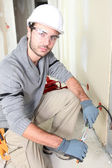 Electrician stripping a wire — Stock Photo