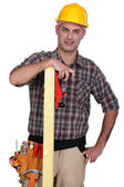 Craftsman holding a wooden board — Stock Photo