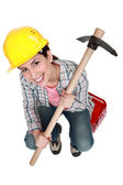 Woman holding pick-axe — Stock Photo