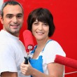 Couple painting wall with roller — Stock Photo