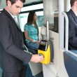 Stock Photo: Man validating ticket on tram