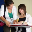Стоковое фото: Teenagers talking about their assignments