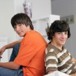 Stockfoto: Teens with console