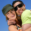 Couple hugging against a blue sky - 