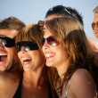 Foto Stock: Group of happy young on holiday