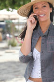Attractive woman talking on her mobile phone — Stock Photo