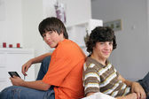 Teens with console — Stock Photo