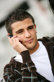 Portrait of a young man with a phone — Stock Photo
