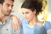 Concerned young couple — Stock Photo