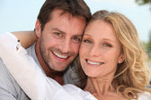 Couple stood with arms around each other — Stock Photo