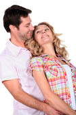 Affectionate couple stood together — Stock Photo