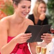 Womlooking at menu at restaurant — Foto de stock #8800206