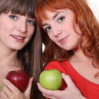 Two women with apples — Stock Photo