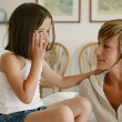 Little girl whispering secrets to her mom — Stock Photo