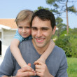 Father and son playing in the garden — Stock Photo #8802919