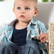 Little boy watching television with a toy car — Stock Photo
