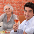 Man and grandmother in restaurant - Stock Photo