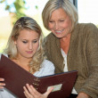 Looking at a family photo album — Stock Photo