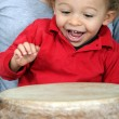 Little boy playing with djembe — Stock Photo #8805373