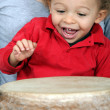 Little boy playing with djembe - Stock Photo