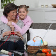 Young girl spending time with grandma - Stock Photo