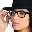 Woman wearing a hat and thick-framed glasses — Stock Photo #8807136