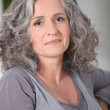 Portrait of relaxed gray-haired woman — Stock Photo
