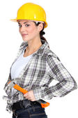 Flirtatious brunette carpenter — Stock Photo