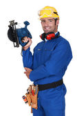 Young blue collar with protective equipment and sander machine — Stock Photo