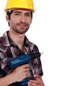 Confident handyman holding drill — Stock Photo